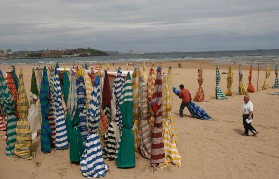 Casetas en la playa de San Lorenzo