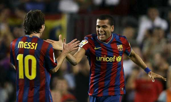 Dani Alves y Leo Messi