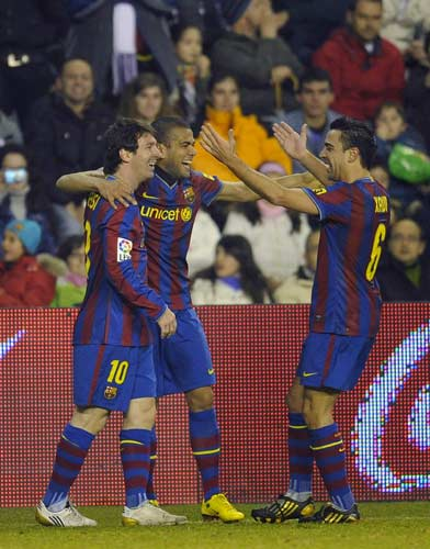Alves, Messi y Xavi