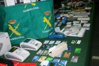 La Benemérita detiene a 17 personas e imputa a otras cuatro de una banda dedicada a estafa y falsificación de moneda