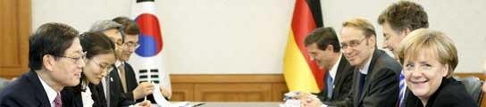 Merkel se reúne con Kim Hwang-sik