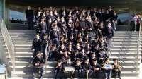 Una banda infantil pregona con música la Semana Santa entre niños ingresados en el Hospital Virgen del Rocío
