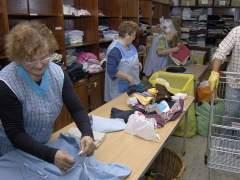 Menos familias españolas acuden a Cáritas pero piden más ayuda