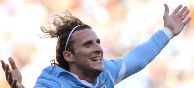 Diego Forl�n, celebrando un gol.