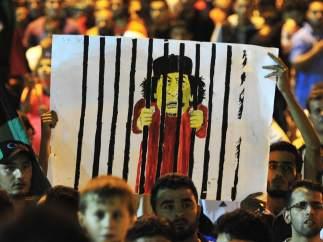 Todos miran a Gadafi
