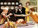 'Thanksgiving Dinner, children breaking wishbone'