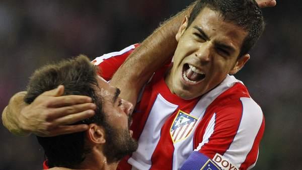 Adrián y Domínguez con el Atlético