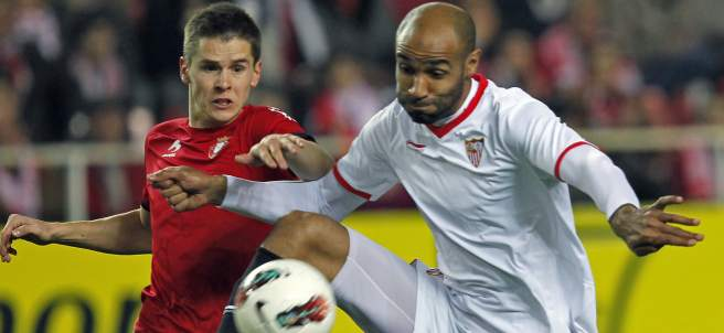 Kanouté y Raitala en el Sevilla - Osasuna