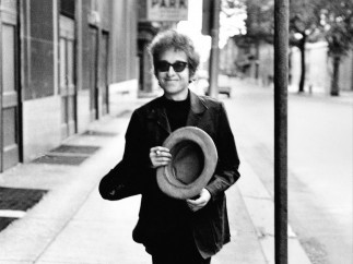 'Bob Dylan walking with top hat'