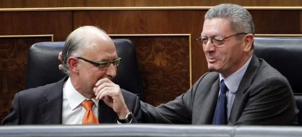 Alberto Ruiz Gallardón y Cristobal Montoro