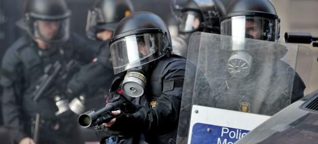 Mossos en los disturbios del 29-M en Barcelona
