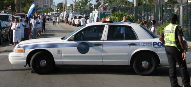 Polic�a