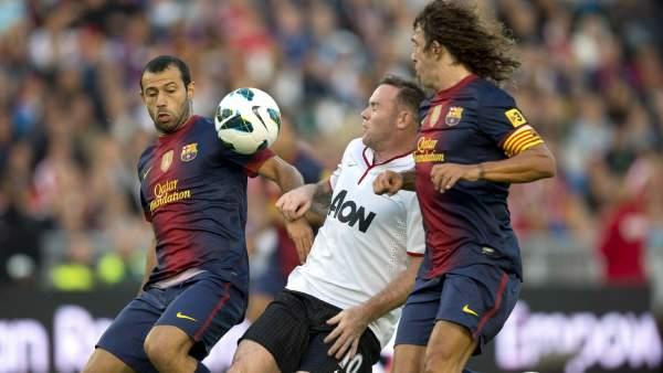 Rooney, Puyol y Mascherano en el Barça - United