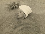 César Moro buried up to his head in sand, c.1935