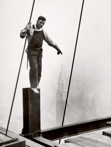 Steelworker standing on beam 1931