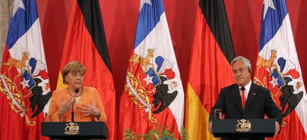 Sebasti�n Pi�era y Angela Merkel