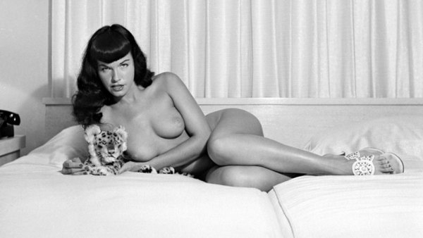 'Bettie Page reclining with stuffed animal'