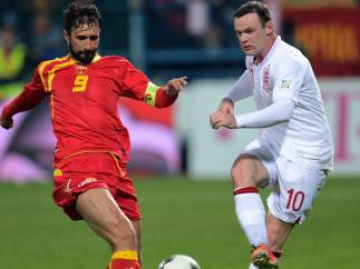 Vucinic y Rooney en el Montenegro - Francia
