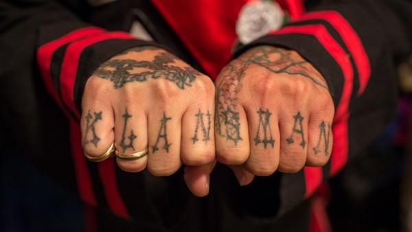 """""""Klansman"""" tattoo on the hands of an Imperial Knighthawk (security position)"""