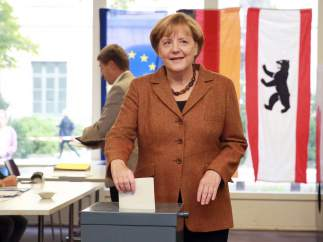 Merkel, votando