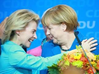 Angela Merkel y su equipo, de celebración