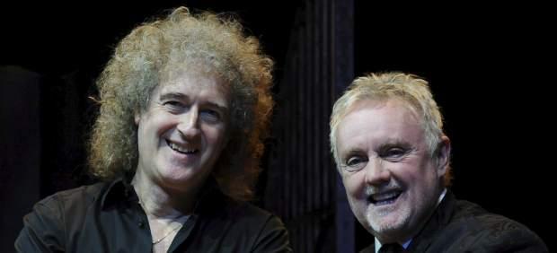 Roger Taylor, batería de Queen (derecha) y Brian May, su guitarrista.