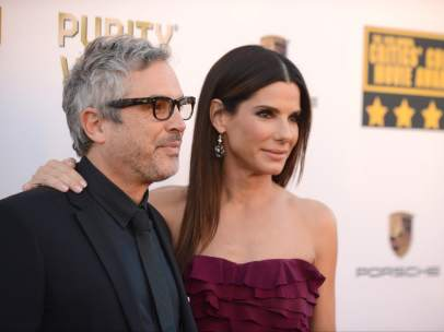 Alfonso Cuarón y Sandra Bullock