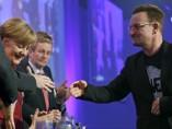 Bono, con Merkel