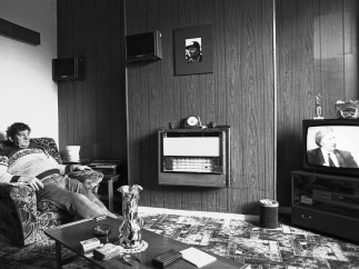 A miner watches a interview with NUM President Arthur Scargill Wombwell, 1984