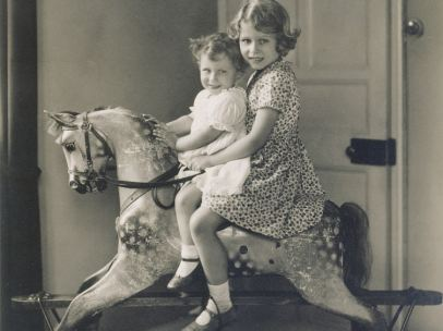 'Princess Elizabeth and Princess Margaret on a rocking horse', August 1932