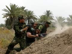 Milicias y soldados iraqu�es contra los yihadistas