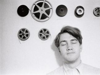 David Lynch with film reels, ca. 1966-70