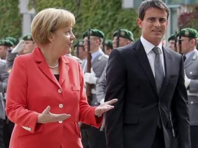 Angela Merkel y Manuel Valls
