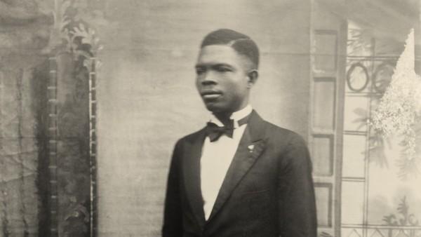 Self-portrait with painted studio backdrop, Benin City, Nigeria, c. 1942