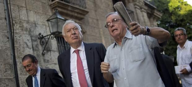 Plante de Raúl Castro a Margallo, que regresa a España pidiendo a Cuba