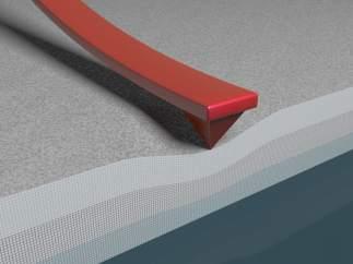 Reproducción esquemática de la nanopunta de un microscopio AFM que ejerce una presión sobre el material al mismo tiempo que mide su conducción eléctrica.