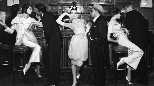 Richard Avedon: Audrey Hepburn and Art Buchwald, with Simone D'Aillencourt, Frederick Eberstadt, Barbara Mullen, and Dr. Reginald Kernan, evening dresses by Balmain, Dior, and Patou, Maxim's Paris, August