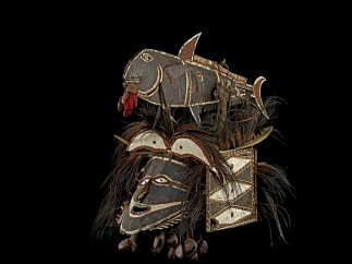 Mask in the form of a human face and a bonito fish, Attributed to Kuduma, Murala. Turtle shell, goa nut, cassowary feather, shell. Nagir, Torres Strait, Queensalnd, Australia before 1888.