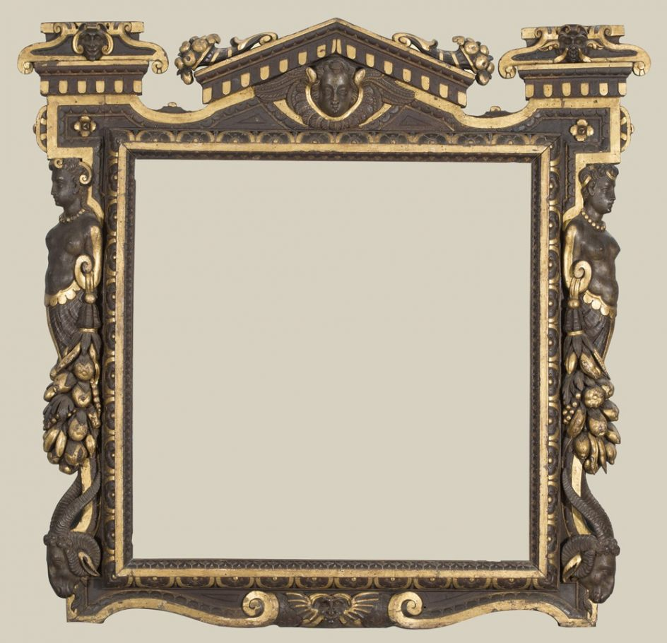 A partially gilded carved walnut Sansovino frame, probably dating from the 1550s