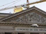 Pancarta de Greenpeace junto al Congreso
