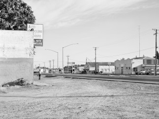 Man Walks AloneThrough Empty Lot, Intersection of South 9th Street and River Road, Modesto, CA, 2012