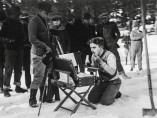 """Chaplin putting on his makeup during location filming for """"The Gold Rush"""" (1925)"""
