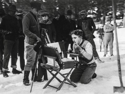 "Chaplin putting on his makeup during location filming for ""The Gold Rush"" (1925)"