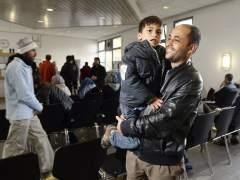 Los primeros refugiados reubicados en la UE parten desde Italia a Suecia