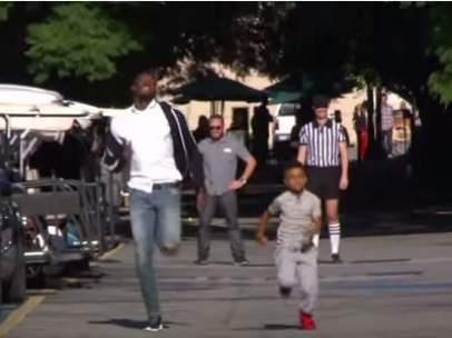 Usain Bolt y un niño