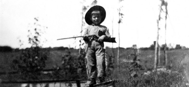 """Ernest Hemingway at """"almost four years of age."""" Image reproduced from his mother's scrapbook, volume II, 1901–1904"""