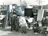 Irving Haberman - Out After 6 Years. Standing Miserably Amid Their Furniture Outside Their Three-Room Apartment at 2650 E. 7th St., Brooklyn, March 1948