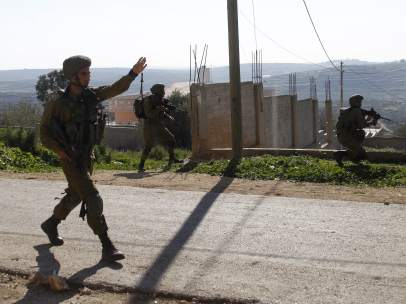 Soldados israelíes en los disturbios de Qadomem