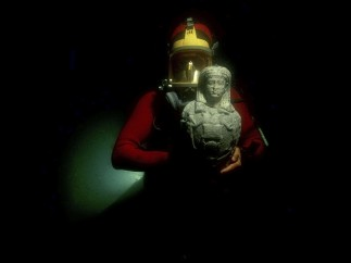 A diver brings to light an Osiris-Canopus found at the site of Canopus Aboukir Bay, Egypt