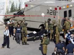Soldado israelí y palestino fallecido